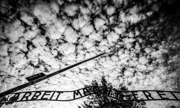 Arbeit macht frei with cloudy sky